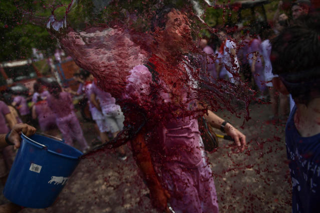<p>A man has wine thrown on his as he takes part in a wine battle, in the small village of Haro, northern Spain, Friday, June 29, 2018. (Photo: Alvaro Barrientos/AP) </p>