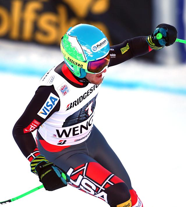 Ted Ligety, of the United States, celebrates after winning an alpine ski, men's World Cup super-combined, in Wengen, Switzerland, Friday, Jan. 17, 2014. (AP Photo/Giovanni Auletta)