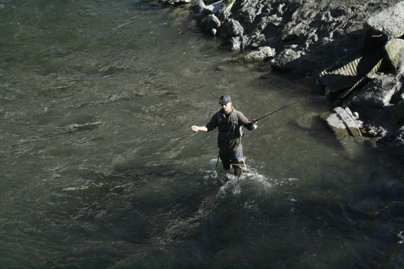 This Aug. 16, 2011, photo shows Cody Ayers of Anchorage, Alaska, fishing for silver salmon in Ship Creek in Anchorage, Alaska. Many people are surprised when they find out Ship Creek, one of Alaska's most popular fishing spots, is located in the heart of downtown Anchorage, Alaska. (AP Photo/Mark Thiessen)