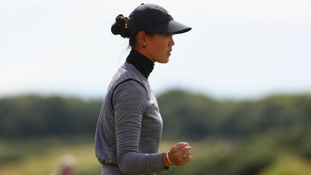 Record-breaking Wie storms into British Open lead