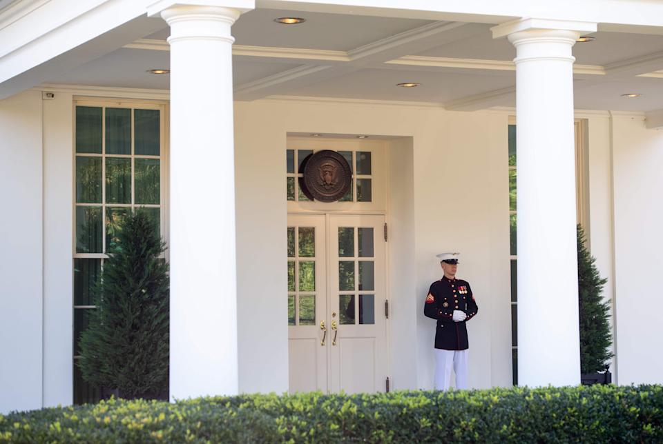 When a Marine is posted outside the West Wing, the president is in the Oval Office (AFP via Getty Images)