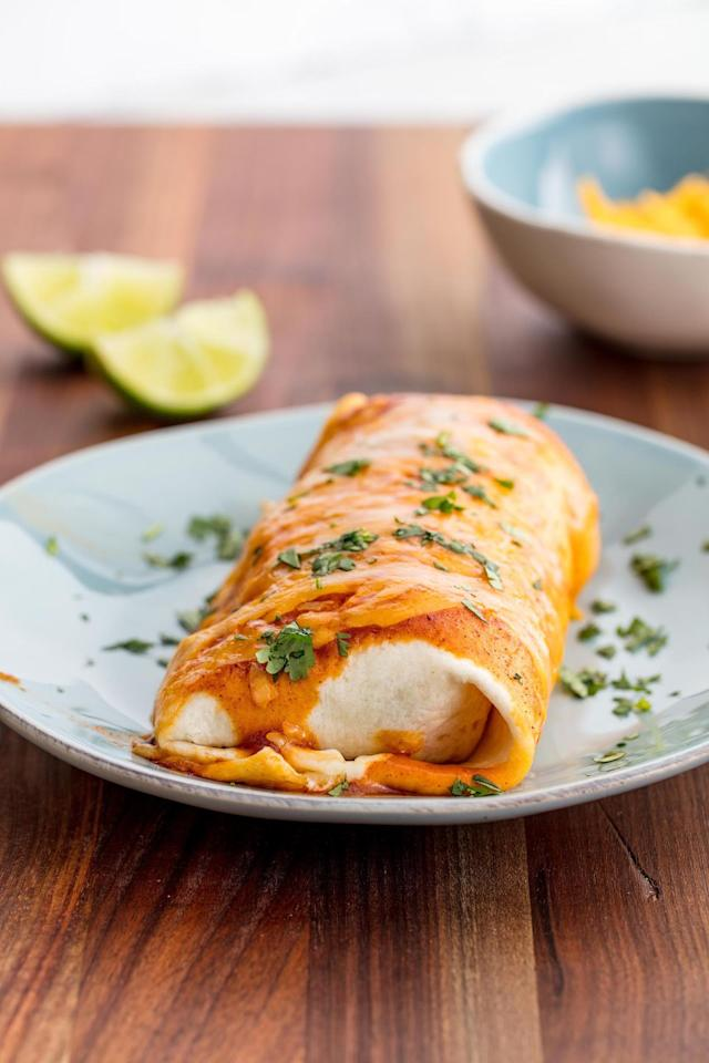"""<p>100x better than a frozen burrito.<br><br>Get the recipe from <a href=""""https://www.delish.com/cooking/recipe-ideas/recipes/a49705/cheesy-baked-burritos-recipe/"""" target=""""_blank"""">Delish</a>.</p>"""