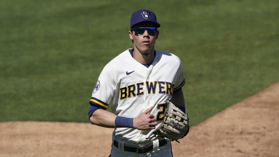 Milwaukee Brewers right fielder Christian Yelich (22) runs to the dugout during a spring training baseball game Saturday, March 6, 2021, in Scottsdale, Ariz. (AP Photo/Ashley Landis)