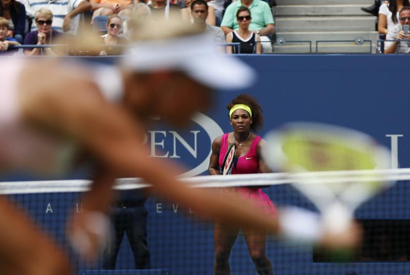 Czech Republic's Andrea Hlavackova returns a shot to Serena Williams in the fourth round of play at the 2012 US Open tennis tournament,  Monday, Sept. 3, 2012, in New York. Williams won the match. (AP Photo/Julio Cortez)