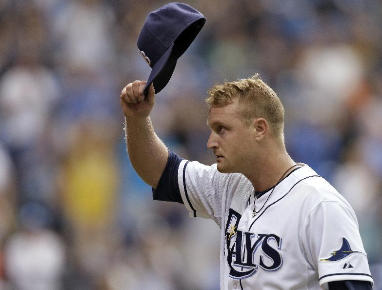 Tampa Bay Rays starting pitcher Alex Cobb tips his hat to the crowd after being taken out of the game against the Baltimore Orioles in the eighth inning of a baseball game Saturday, Sept. 21, 2013, in St. Petersburg, Fla. The Rays won the game 5-1.(AP Photo/Chris O'Meara)