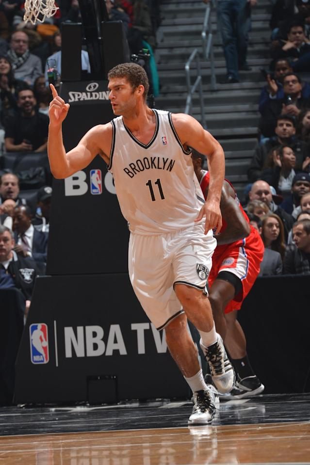 BROOKLYN, NY - DECEMBER 12: Brook Lopez #11 of the Brooklyn Nets runs back on defense against the Los Angeles Clippers on December 12, 2013 at the Barclays Center in Brooklyn, New York. (Photo by Jesse D. Garrabrant/NBAE via Getty Images)