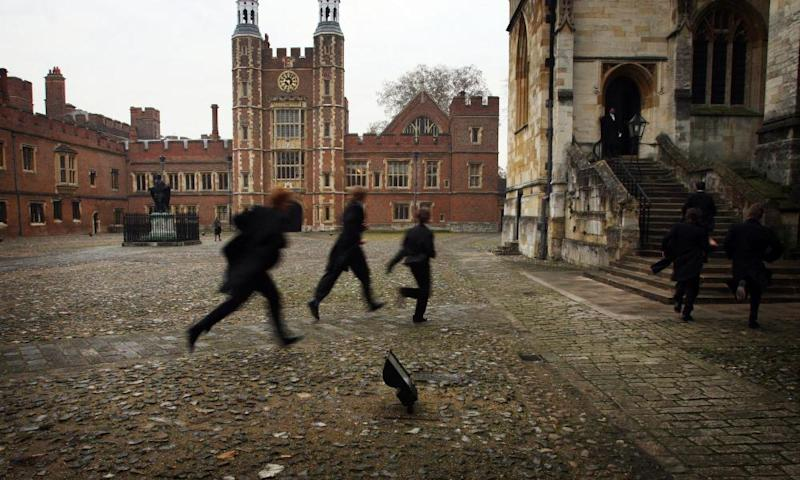 Pupils running across Eton's cobbled school yard for fear of being late for chapel