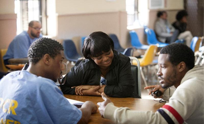 """This image released by The Weinstein Company shows, from left, Michael B. Jordan, Octavia Spencer and director Ryan Coogler during the filming of """"Fruitvale Station."""" The film, released in select theaters last week and opening wide next weekend, tells the story of Oscar Grant, an unarmed black man shot to death by a white police officer in a San Francisco train station on New Year's Day, 2009. The officer was convicted of involuntary manslaughter and served 11 months in prison. It was Spencer's first high-profile role since her Academy Award-winning role as a feisty maid in the racial dramedy """"The Help."""" (AP Photo/The Weinstein Company, Ron Koeberer )"""