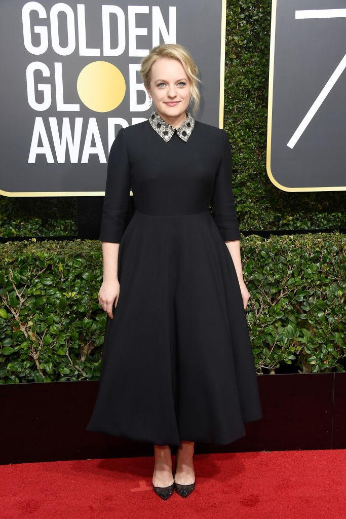 <p>The star of<em> The Handmaid's Tale</em>, who won Best Actress in a TV Series — Drama, attends the 75th Annual Golden Globe Awards at the Beverly Hilton Hotel in Beverly Hills, Calif., on Jan. 7, 2018. (Photo: Steve Granitz/WireImage) </p>