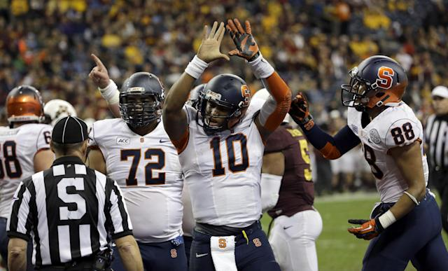Syracuse quarterback Terrel Hunt (10) celebrates his rushing touchdown against Minnesota during the third quarter of the Texas Bowl NCAA college football game on Friday, Dec. 27, 2013, in Houston. Syracuse won 21-17. (AP Photo/David J. Phillip)