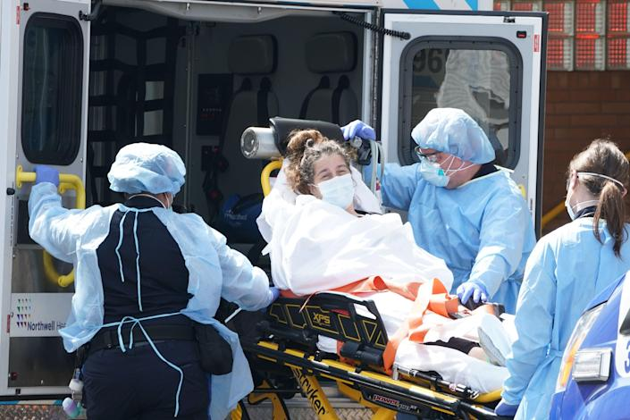A woman arrives by ambulance to Wyckoff Hospital in the Bushwick section of Brooklyn April 5, 2020 in New York. Governor Andrew Cuomo reported that the coronavirus death toll in New York state spiked to 4,159, up from 3,565 a day prior. (Bryan R. Smith / AFP/Getty Images)