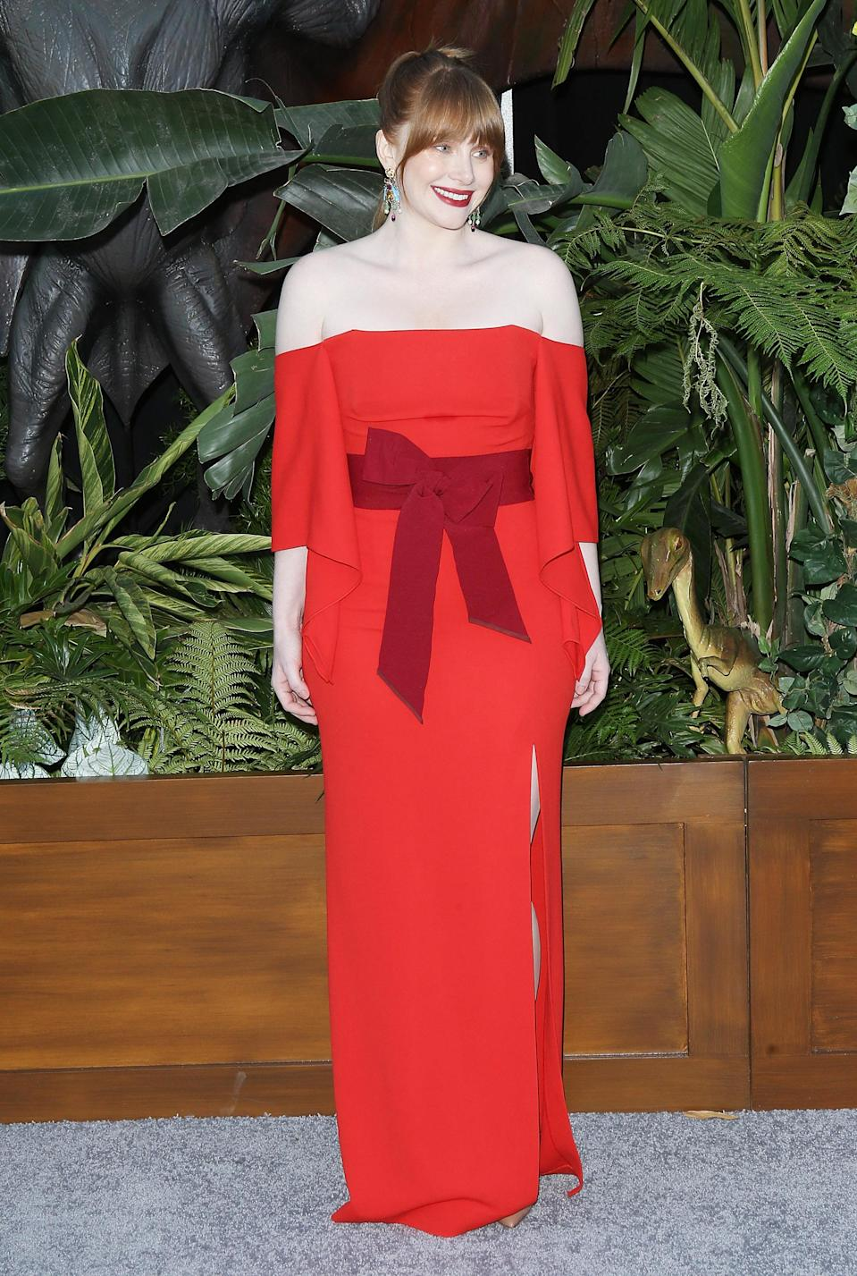 <p>The film's co-lead turned to French designer Roland Mouret for her premiere look; a lipstick red column dress with a bow waist and off-the-shoulder cut. <em>[Photo: Getty]</em> </p>