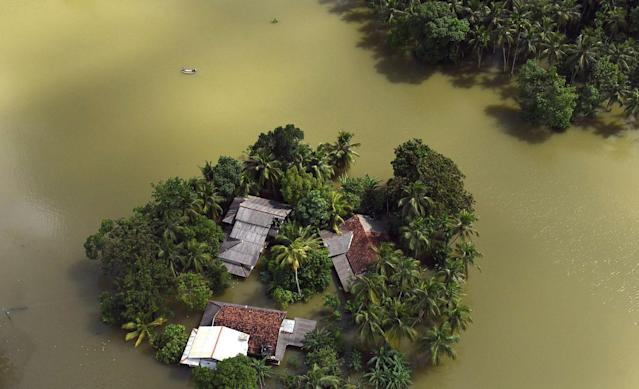 <p>Houses are submerged in floodwaters in Sri Lanka. Helicopters searched for people still marooned after rain-triggered floods and mudslides inundated villages 28, 2017 (Sri Lanka Air Force via AP) </p>