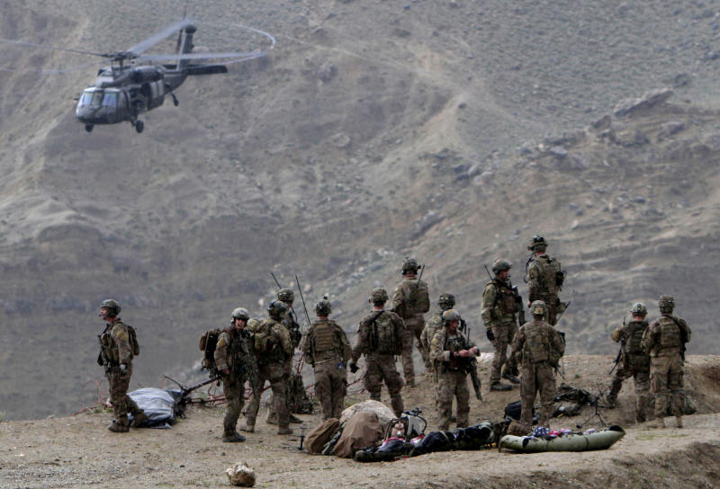 U.S. Black Hawk helicopter arrives to the scene after a NATO helicopter crashed killing two American service members in a field near Gerakhel, eastern Afghanistan, Tuesday, April 9, 2013. The U.S.-led International Security Assistance Force said the cause of the crash is under investigation but initial reporting indicates there was no enemy activity in the area at the time. It did not immediately identify the nationalities of those killed. But a senior U.S. official confirmed they were Americans. (AP Photo/Rahmat Gul)