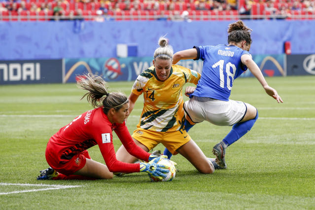Ilaria Mauro #18 of Italy challenges Alanna Kennedy #14 and Lydia Williams #1 of Australia during the 2019 FIFA Women's World Cup France group C match between Australia and Italy at Stade du Hainaut on June 9, 2019 in Valenciennes, France. (Photo by Catherine Steenkeste/Getty Images)