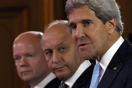 US Secretary of State Kerry, British Foreign Secretary Hague and French Foreign Minister Fabius attend a news conference after a meeting on Syria conflict at the Quai d'Orsay ministry in Paris