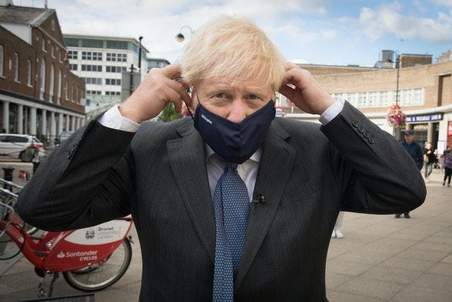 Prime Minister Boris Johnson meets shoppers and shopkeepers during a visit to his constituency in Uxbridge, west London