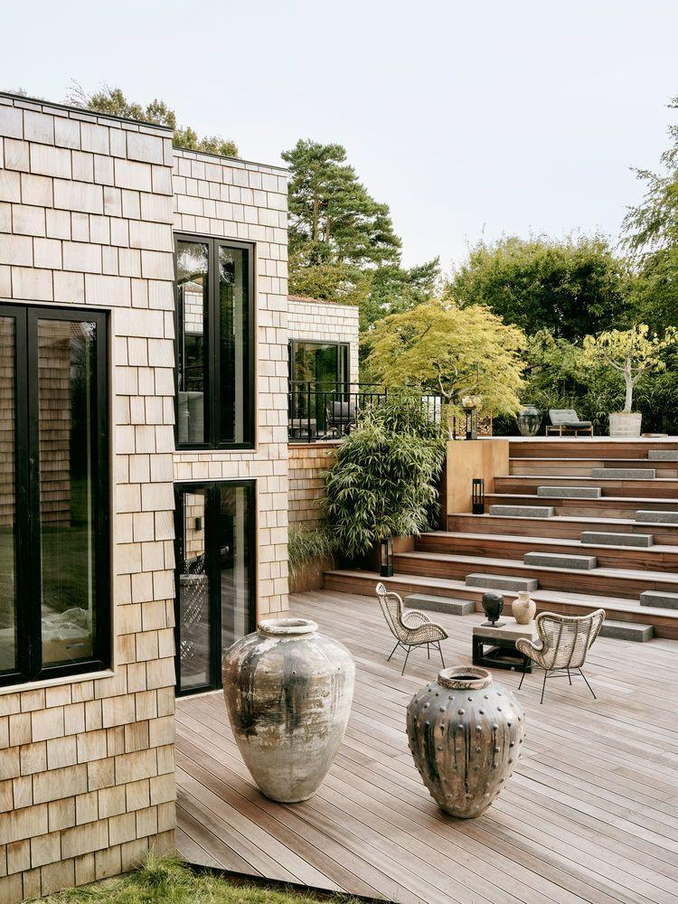 """<p>Gardens with level changes can sometimes be seen as problematic, but with a bit of thought they can add real interest. Don't just think of them as places for stairs and retaining walls – with clever planning, they can be much more. The garden of Danish fashion designer Naja Munthe was inspired by Roman amphitheatres. Its broad jatoba (Brazilian cherry) steps provide masses of informal seating for parties and gatherings. Read our <a href=""""https://elledecoration.co.uk/decorating/a36155115/garden-flooring/"""" rel=""""nofollow noopener"""" target=""""_blank"""" data-ylk=""""slk:guide to decking"""" class=""""link rapid-noclick-resp"""">guide to decking</a> for more inspiration.<br></p>"""