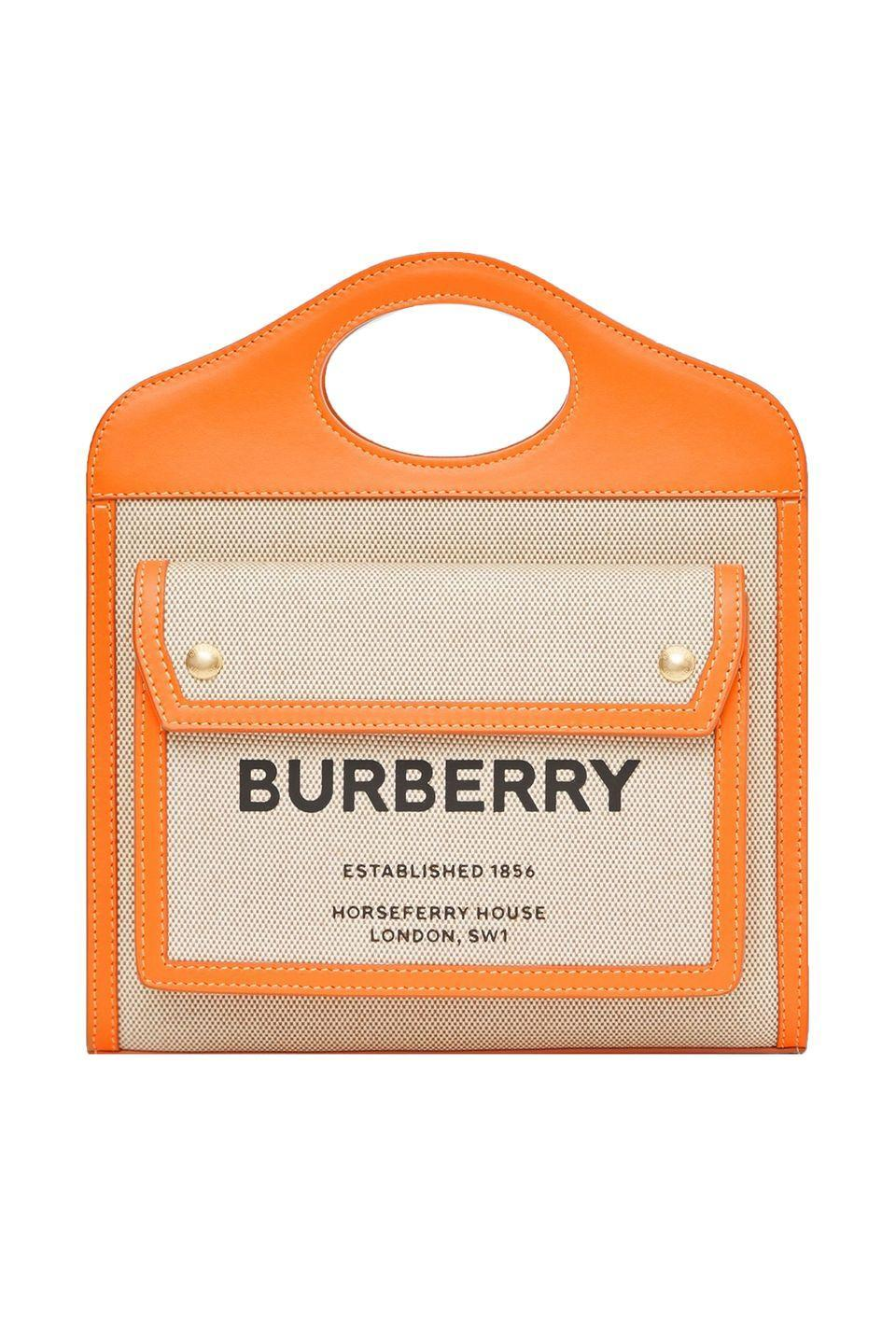 "<p>Burberry's new pocket bag marries the London label's archives, with a thoroughly modern shape. The crisp structure and contrast trim in traffic cone orange make it best for those looking to stand out. </p><p><em>Burberry, $1,090, burberry.com</em></p><p><a class=""link rapid-noclick-resp"" href=""https://go.redirectingat.com?id=74968X1596630&url=https%3A%2F%2Fus.burberry.com%2Fmini-two-tone-canvasleather-pocket-bag-p80323321&sref=https%3A%2F%2Fwww.elle.com%2Ffashion%2Fshopping%2Fg33416567%2Fdesigner-it-bags-pre-fall-2021%2F"" rel=""nofollow noopener"" target=""_blank"" data-ylk=""slk:SHOP NOW"">SHOP NOW</a></p>"