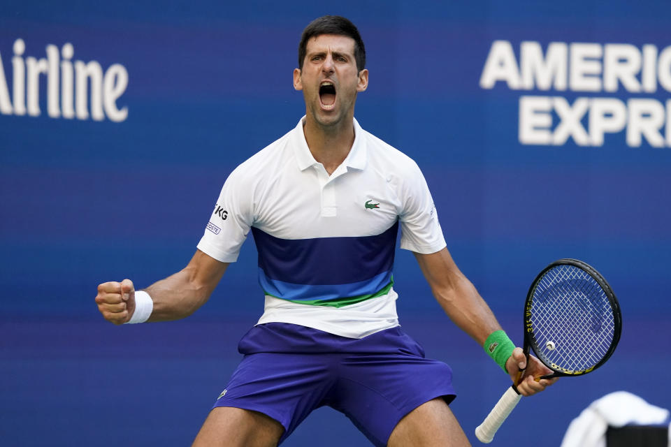 Novak Djokovic, of Serbia, reacts after scoring a point against Kei Nishikori, of Japan, during the third round of the US Open tennis championships, Saturday, Sept. 4, 2021, in New York. (AP Photo/John Minchillo)