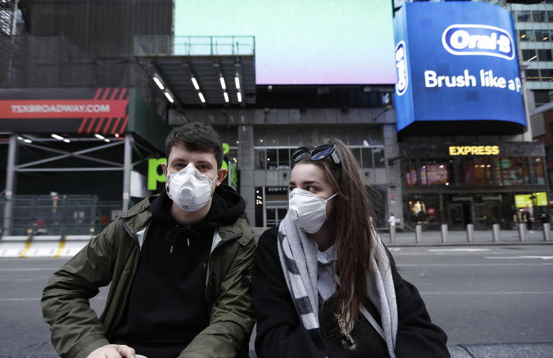 Visitors to the theatre district wear face masks as a precaution against the spread of Coronavirus at the Times Square. Amid the COVID19 (coronavirus) concerns and a ban on groups of 500 of people, a directive issued by New York State Andrew Cuomo, all of Broadway performances have been closed until April 12, 2020. President Charlotte St. Martin of the Broadway League issued statement stating that Broadway is committed to enrich and foster enrichment and to inspire all the while entertain its visitors. Additionally, the league is committed to protect all those who work in the industry. (Photo by John Lamparski / SOPA Images/Sipa USA)