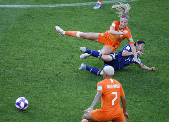 Netherlands' Jackie Groenen is tackled by Japan's Narumi Miura during the Women's World Cup round of 16 soccer match between the Netherlands and Japan at Roazhon Park, in Rennes, France, Tuesday, June 25, 2019. (AP Photo/Francois Mori)