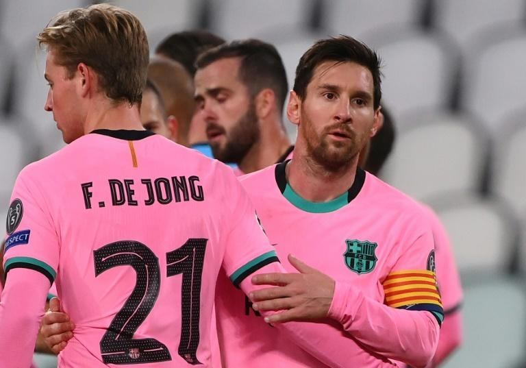 Lionel Messi with Frenkie de Jong at the end of Barcelona's 2-0 win away to Juventus