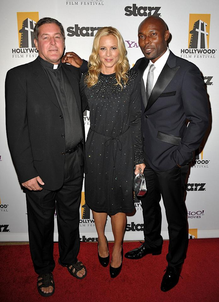 """Father Rick Frechette, <a href=""""http://movies.yahoo.com/movie/contributor/1800019251"""">Maria Bello</a> and <a href=""""http://movies.yahoo.com/movie/contributor/1808445924"""">Jimmy Jean-Louis</a> at the 13th Annual Hollywood Awards Gala held at the Beverly Hilton Hotel - 10/26/2009"""