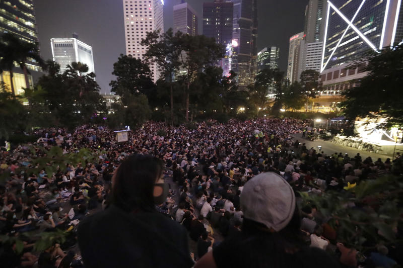 CORRECTS DATE Protesters gather during a rally in Hong Kong on Saturday, Oct. 26, 2019. Hong Kong authorities have won a temporary court order banning anyone from posting personal details or photos of police officers online, in their latest effort to clamp down on the city's protest movement. (AP Photo/Mark Schiefelbein)