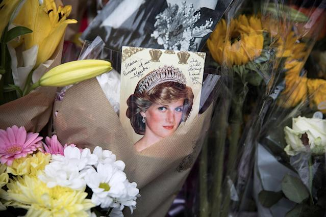 <p>Well-wishers and Royal 'enthusiasts' gather outside the gates of Kensington Palace where tributes continue to be left, on the 20th anniversary of the death of Princess Diana on Aug. 31, 2017 in London, England. (Photo: Dan Kitwood/Getty Images) </p>