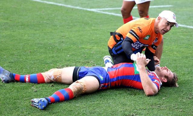 "<span class=""element-image__caption"">Brendan Elliot of the Knights is assessed for injury after being felled during the game against South Sydney at the weekend.</span> <span class=""element-image__credit"">Photograph: Ashley Feder/Getty Images</span>"
