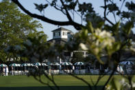 Dogwood flowers frame the clubhouse during a practice round for the Masters golf tournament on Monday, April 5, 2021, in Augusta, Ga. (AP Photo/David J. Phillip)