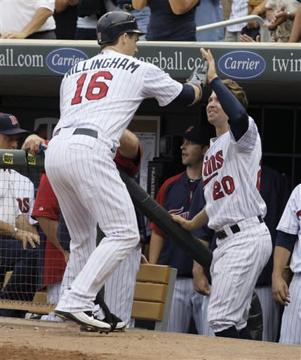 Minnesota Twins' Josh Willingham (16) is congratulated by teammate Brian Dozier (20) after hitting a two-run home run during the fourth inning in a baseball game against the Cleveland Indians, Saturday, July 28, 2012, in Minneapolis. (AP Photo/Paul Battaglia)