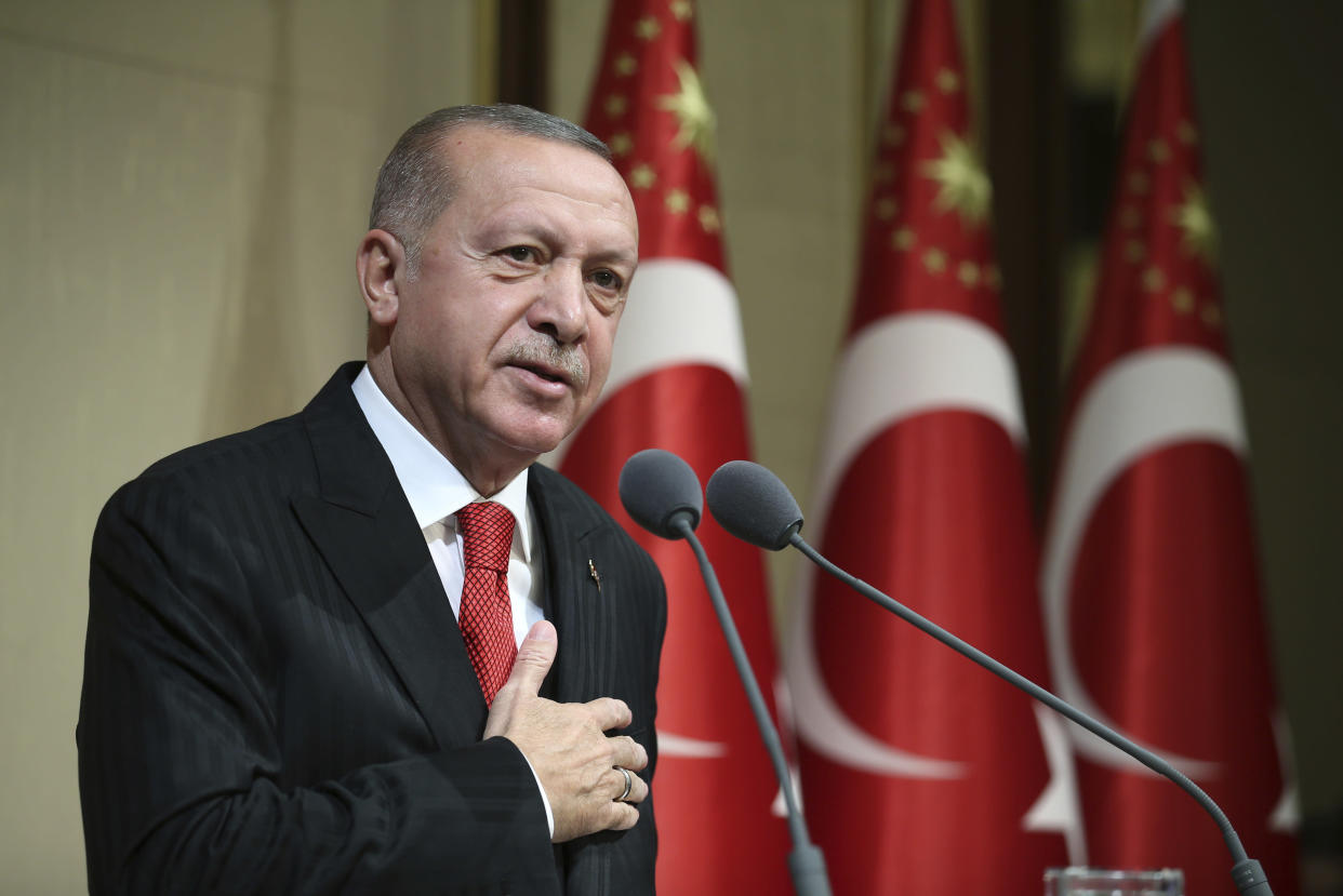 "Turkish President Recep Tayyip Erdogan speaks during a reception on Republic Day, in Ankara, Turkey, Tuesday, Oct. 29, 2019. Erdogan said Russia has informed Turkey that Syrian Kurdish fighters have "" completely been removed "" from the areas in northeast Syria. (Presidential Press Service via AP, Pool)"
