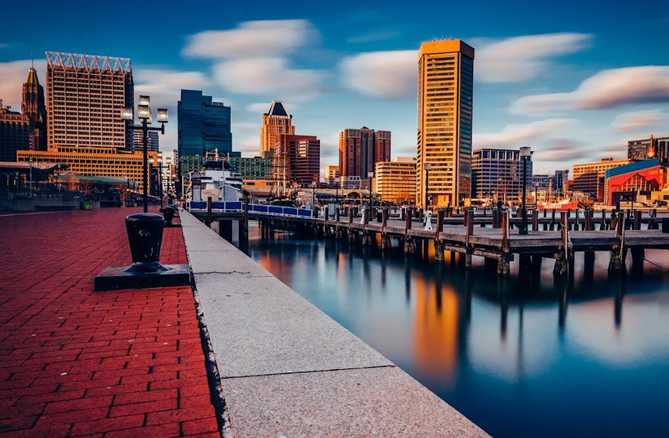 the Baltimore skyline and Inner Harbor Promenade in Baltimore, Maryland