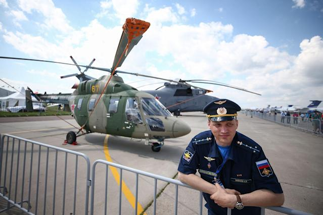 <p>A pilot seen by a Kamov Ka-226 small multi-purpose helicopter on display at the MAKS-2017 International Aviation and Space Salon in Zhukovsky, Moscow Region, Russia, July 18, 2017. (Photo: Sergei Bobylev/TASS via Getty Images) </p>
