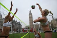 LONDON, ENGLAND - MAY 24: Members of Great Britain women's Beach Volleyball team (L-R) Lucy Bolton, Zara Dempney and Shauna Mullin take part in a 'Stop Traffic' photocall on Parliament Square on May 24, 2012 in London, England. The PR stunt was aimed at reminding commuters that roads were likely to be busier at peak times during the 2012 London Olympic Games. (Photo by Dan Kitwood/Getty Images)