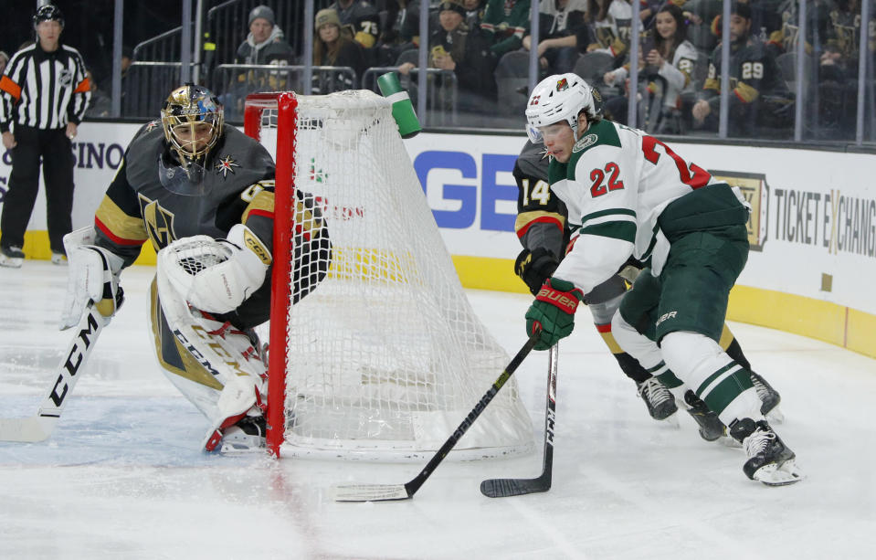 Minnesota Wild left wing Kevin Fiala (22) attempts a wrap around shot on Vegas Golden Knights goaltender Marc-Andre Fleury (29) during the first period of an NHL hockey game Tuesday, Dec. 17, 2019, in Las Vegas. (AP Photo/John Locher)