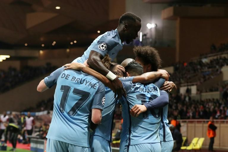 Manchester City's players celebrate a goal against Monaco in the Champions League but it was not enough to prevent them crashing out