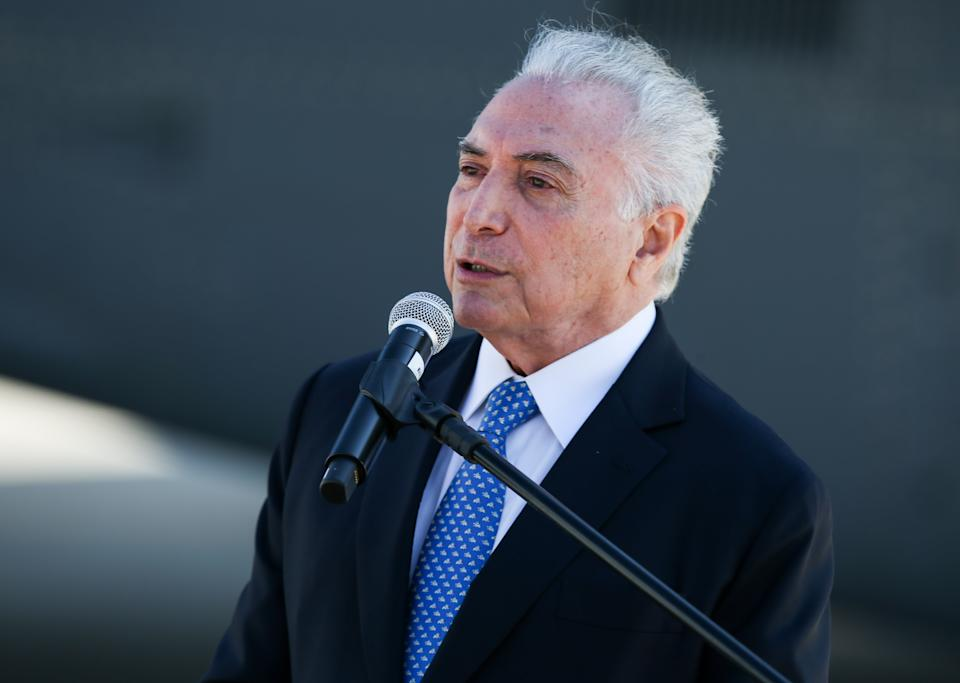 SAO PAULO, BRAZIL - AUGUST 12: Brazil's former President Michel Temer, designated to represent Brazil in the mission to help Lebanon, speaks during a visit to BASP (Sao Paulo Air Base) to accompany the Brazilian delegation's departure to Lebanon on August 12, 2020 in Sao Paulo, Brazil. Last week, an explosion in the port area of Beirut, the capital of Lebanon, left at least 160 dead and thousands injured. The delegation's mission is to deliver food, medicine and hospital supplies, including 100,000 surgical masks and mechanical respirators. (Photo by Alexandre Schneider/Getty Images)