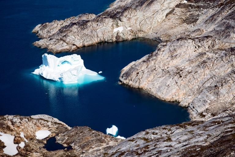 This aerial file photo taken on August 15, 2019 shows an iceberg floating off the eastern coast of Greenland, part of a vast and increasingly coveted Arctic region