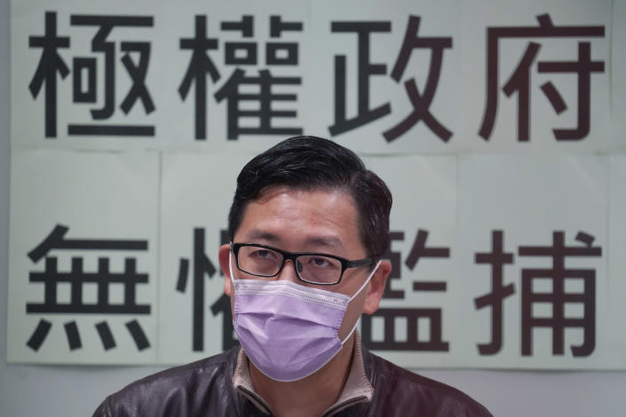 """Former Democratic Party legislator Lam Cheuk-ting speaks during a press conference after being released on bail, in Hong Kong, Friday, Jan. 8, 2021. Some former Hong Kong legislators and pro-democracy activists were released on bail late Thursday after being arrested under Hong Kong's national security law as part of Wednesday's mass arrests of 53 people. The Chinese in the background reads """"Totalitarian government, fearless of indiscriminate arrest."""" (AP Photo/Kin Cheung)"""