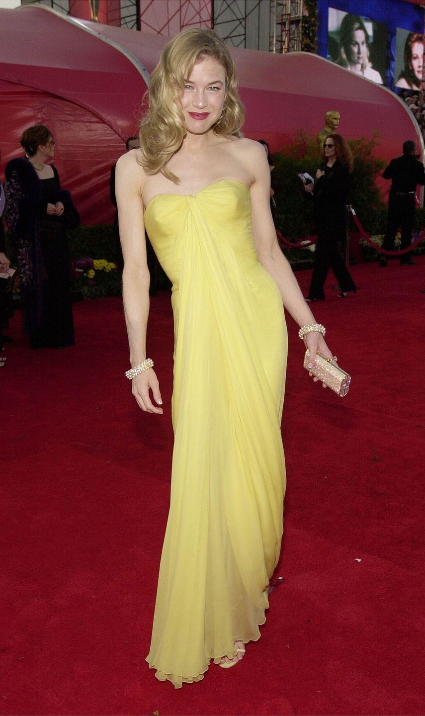 <p>Nominated for her role in <em>Bridget Jones's Diary,</em> Renee Zellweger debuted her return to her svelte figure in a sunny yellow vintage Jean Dessès dress. </p>