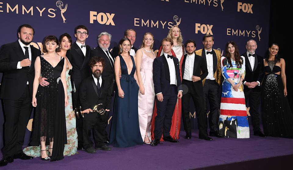 """Maisie Williams, Isaac Hempstead Wright, Emilia Clarke, Peter Dinklage, Sophie Turner, Gwendoline Christie and cast pose with the Emmy for Outstanding Drama Series """"Game Of Thrones"""" during the 71st Emmy Awards at the Microsoft Theatre in Los Angeles on September 22, 2019. (Photo by Robyn Beck / AFP)        (Photo credit should read ROBYN BECK/AFP/Getty Images)"""