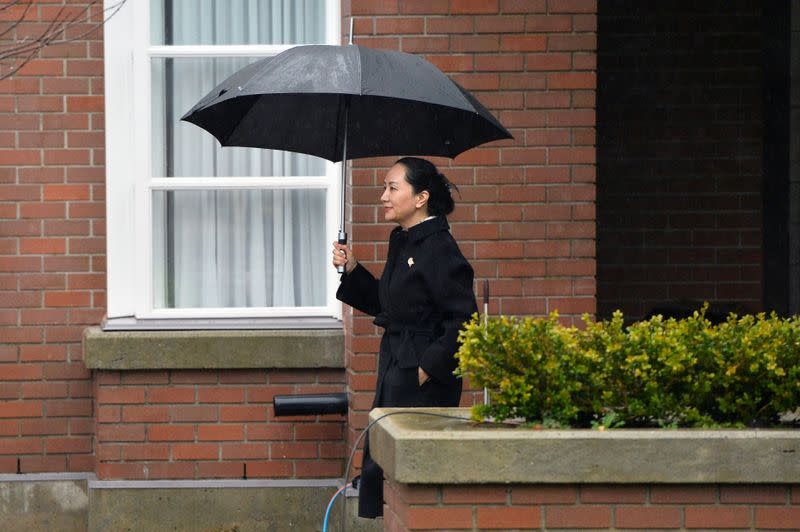 Huawei Chief Financial Officer Meng Wanzhou leaves her home to attend her extradition hearing at B.C. Supreme Court in Vancouver