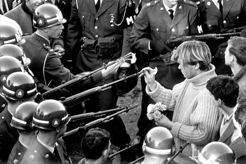 <p>Antiwar demonstrators try flower power on soldiers blocking the Pentagon Building in Arlington, Virginia, on October 21, 1967. </p>