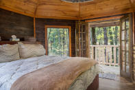 This undated photo provided by The Mohicans Treehouse Resort and Wedding Venue shows one of the treehouses at The Mohicans Treehouse Resort and Wedding Venue in Glenmont, Ohio. Guests can enjoy luxury amenities in these treehouses all year at this resort. (Chris McLelland via AP)