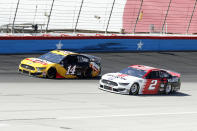 Clint Bowyer (14) and Brad Keselowski (2) come out of Turn 4 during a NASCAR Cup Series auto race at Texas Motor Speedway in Fort Worth, Texas, Sunday, July 19, 2020. (AP Photo/Ray Carlin)
