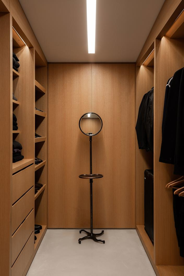 Even the closets in the home are sleek. This one features a 1900s shaving mirror sourced from Orange.