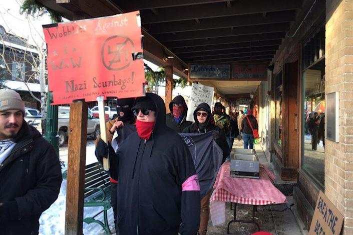 """Activists protest at the """"Love Not Hate"""" gathering in Whitefish, Mont. (Photo: Andrew Romano/Yahoo News)"""